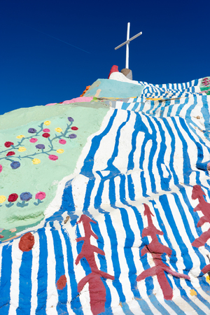 November 17, 2015 Niland, California, USA: Salvation Mountain is a colorful artificial mountain near Slab City. It is made from adobe, straw, and thousands of gallons of paint.