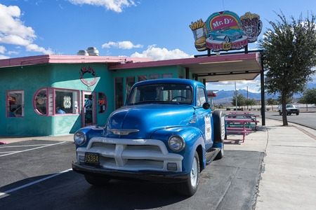 November 10, 2015 Kingman, Arizona,USA: vintage collectors truck on roadside along historic route sixty six in front of famous diner Editorial