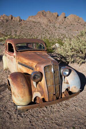 rusty car in the desert Stock Photo