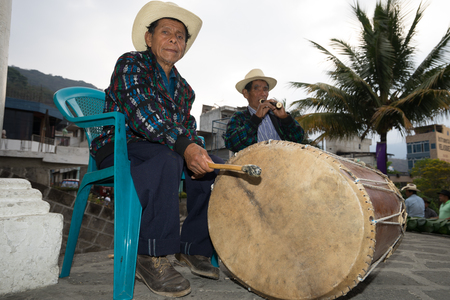 man beating a drum at Easter celebrations in Guatemal