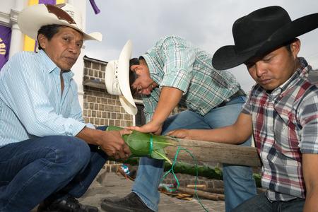 men preparing Easter street decorations in Guatemala.