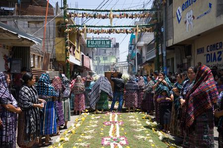 tzutujil mayan women along the decorated street during semana santa in san pedro la laguna guatemala
