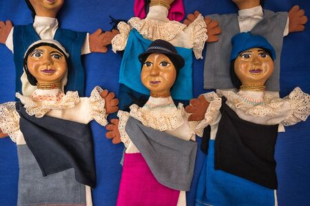 Otavalo, Ecuador- November 25, 2017: closeup of indigenous dolls sold in the Saturday artisan market