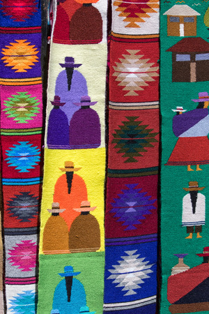 Otavalo, Ecuador-December 23, 2017: indigenous textiles in the Saturday artisan market Фото со стока - 92560323