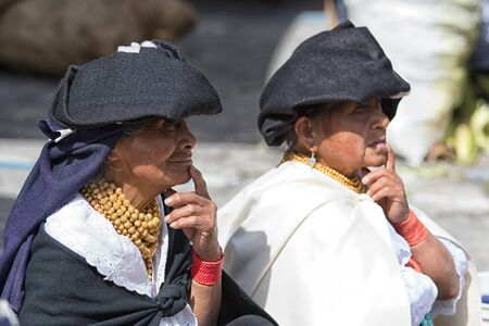 Otavalo, Ecuador-December 23, 2017: indigenous quechua women wearing traditional clothing in the Saturday market Фото со стока - 92560217