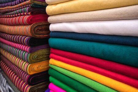 Otavalo, Ecuador- November 25, 2017: closeup of indigenous colourful textiles sold in the Saturday artisan market