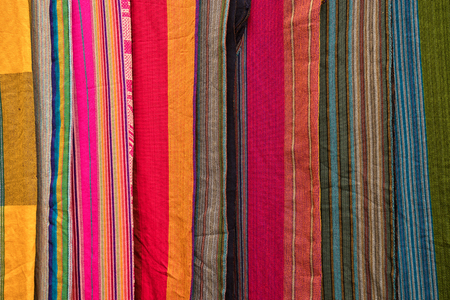 Otavalo, Ecuador - January 13, 2018: indigenous textiles closeup in the Saturday artisan market