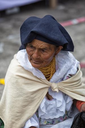 Otavalo, Ecuador - December 30, 2017: indigenous quechua woman at the Saturday market