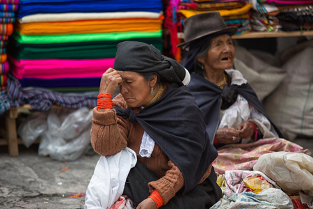 Otavalo, Ecuador - December 30, 2017: indigenous quechua women at the Saturday market Фото со стока - 93826979