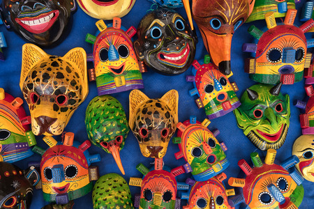Otavalo, Ecuador - February 17, 2018:  closeup of colourful indigenous wood carvings in the Saturday artisan market