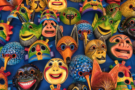 Otavalo, Ecuador - February 17, 2018:  closeup of colourful indigenous wood carvings for sale  in the Saturday artisan market