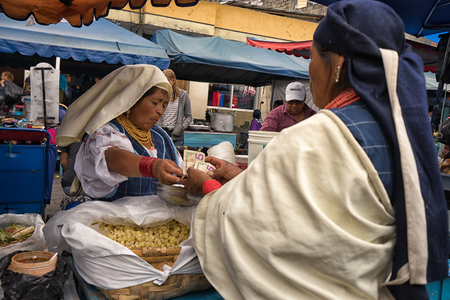 Otavalo, Ecuador - January 13, 2018: indigenous quechua women in the Saturday farmers market Stock fotó - 97671000