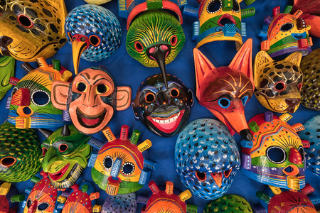 Otavalo, Ecuador - March 3, 2018: closeup of colourful indigenous wood carvings for sale in the Saturday artisan market Фото со стока - 97672358