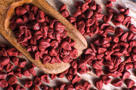 closeup of achiote seeds used for natural coloring Stock Photo