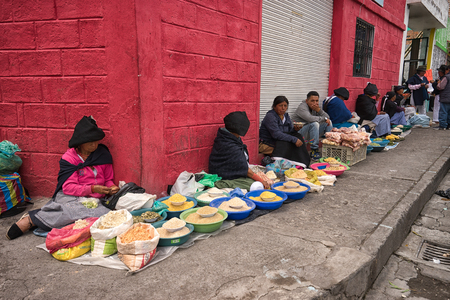 Otavalo, Ecuador-March 31,2018: indigenous people selling produce on the street on market day Stock fotó - 98651218