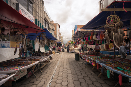 Otavalo, Ecuador-March 31,2018: vendor stands set up on the street on market day