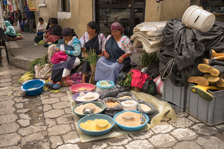 Otavalo, Ecuador-March 31,2018: indigenous people selling produce on the street on market day