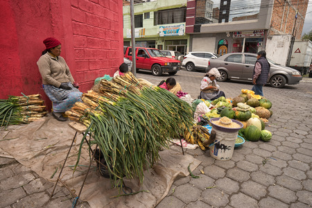 Otavalo, Ecuador-March 31,2018: indigenous people selling produce on the street on market day Фото со стока - 98651378