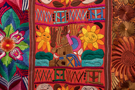 Otavalo, Ecuador- February 17, 2018: indigenous handcrafed textile closeup in the artisan market Sajtókép