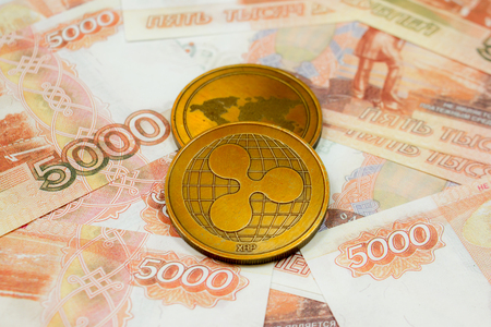 Ripple coin close up on money background.