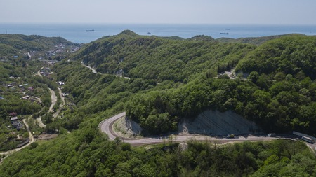 Aerial view of a curved winding road to Sochi Russia trough the mountains