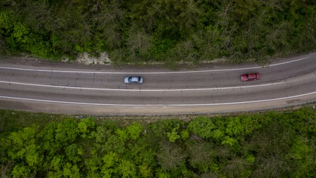 Top down view of a serpentine road trough the Caucasian mountains