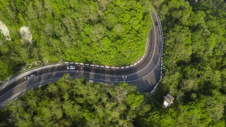 Aerial view of a serpentine winding road trough the mountains