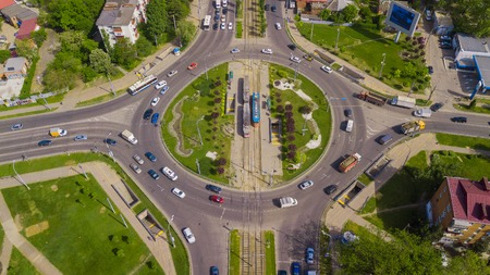 Overhead drone shot of beautiful park and busy roundabout Stock Photo