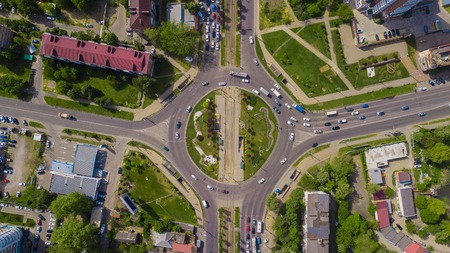Overhead drone shot of beautiful park and busy roundabout