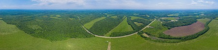Aerial Caucasus forest panoramic background, green fields