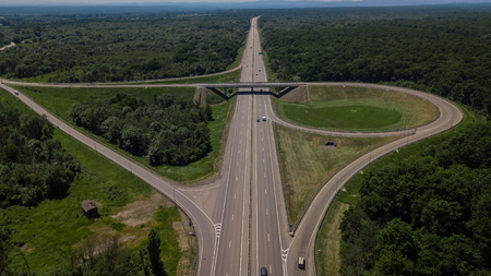 Aerial view of highway cloverleaf interchange seen from above.