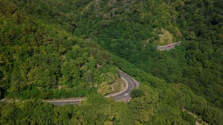 Aerial view from drone - winding road from the high mountain pass in Sochi, Russia.