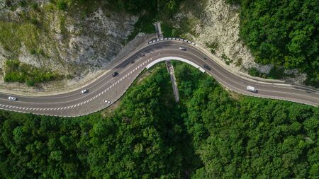 Aerial view from drone - serpentine road, mountain pass in Sochi, Russia. Imagens