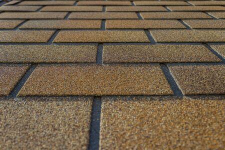 Close-up flexible soft bitumen tile Shinglas. Construction Landscaping