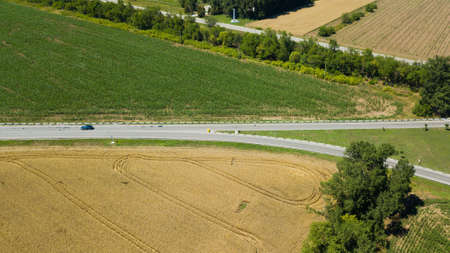 Aerial view of a country road in beautiful agricultural fields in Russia