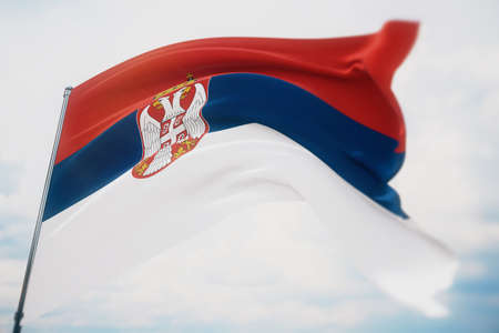 Waving flags of the world - flag of Serbia. Shot with a shallow depth of field, selective focus. 3D illustration.