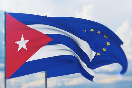 Waving European Union flag and flag of Cuba. Closeup view, 3D illustration. Фото со стока