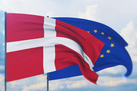 Waving European Union flag and flag of Denmark. Closeup view, 3D illustration. Фото со стока