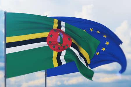 Waving European Union flag and flag of Dominica. Closeup view, 3D illustration. Фото со стока
