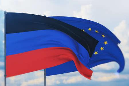 Waving European Union flag and flag of Donetsk Peoples Republic. Closeup view, 3D illustration. Фото со стока