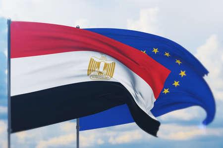 Waving European Union flag and flag of Egypt. Closeup view, 3D illustration. Фото со стока