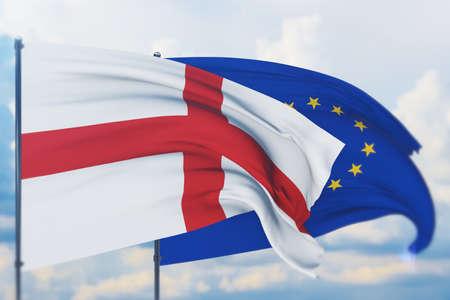 Waving European Union flag and flag of England. Closeup view, 3D illustration. Фото со стока