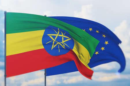 Waving European Union flag and flag of Ethiopia. Closeup view, 3D illustration.