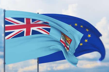 Waving European Union flag and flag of Fiji. Closeup view, 3D illustration.