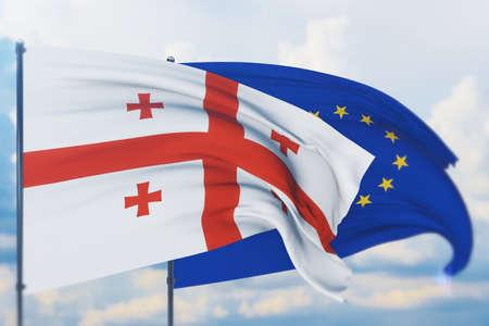 Waving European Union flag and flag of Georgia. Closeup view, 3D illustration.