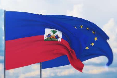 Waving European Union flag and flag of Haiti. Closeup view, 3D illustration.