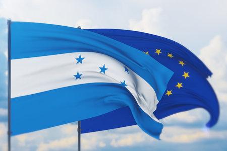 Waving European Union flag and flag of Honduras. Closeup view, 3D illustration.