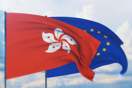 Waving European Union flag and flag of Hong Kong. Closeup view, 3D illustration. Фото со стока