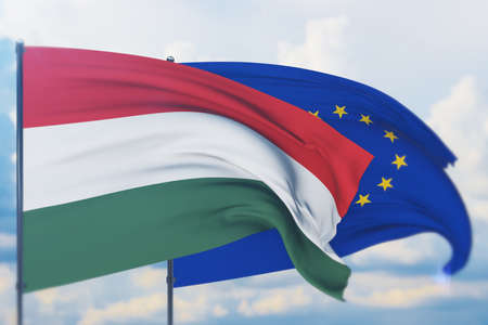 Waving European Union flag and flag of Hungary. Closeup view, 3D illustration.