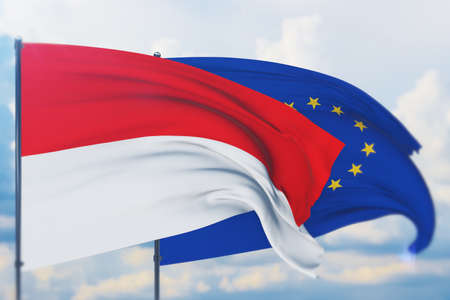 Waving European Union flag and flag of Indonesia. Closeup view, 3D illustration. Фото со стока